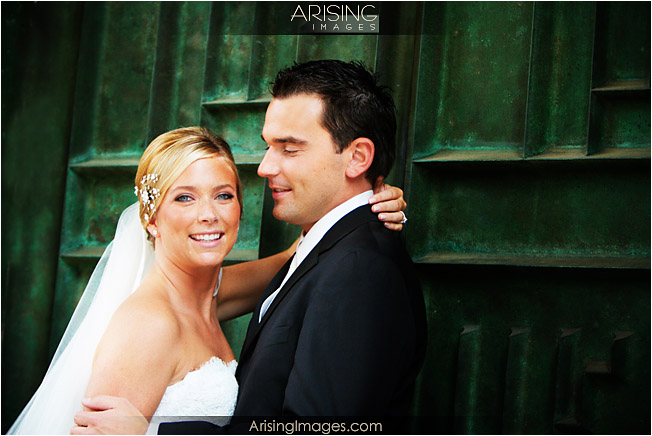 bride and groom by the green doors at the cranbrook art museum