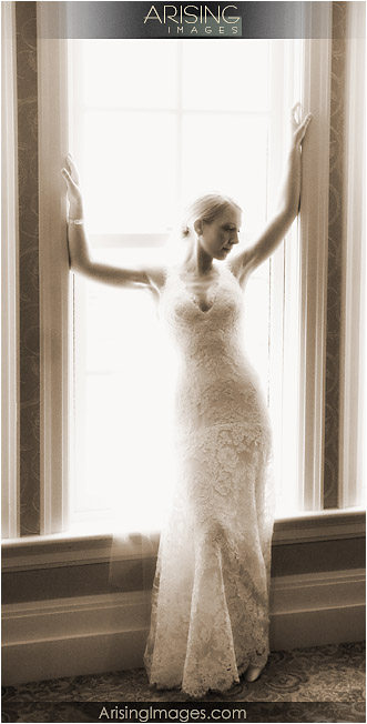 bride by the window at the royal park hotel