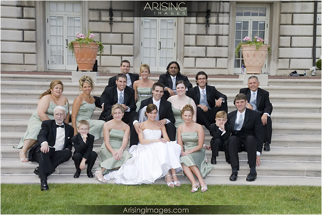 bridal party on steps at the grosse pointe war memorial