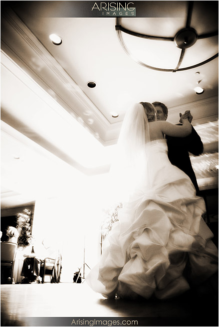 bride and groom dancing at wedding reception at pine lake golf and country club