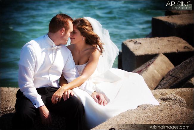wedding photo under blue water bridge
