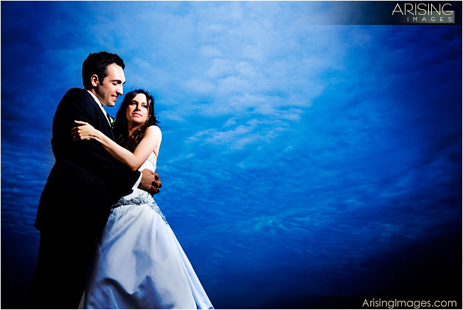 wedding photo with stormy skies along the detroit riverfront