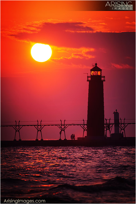 lighthouse at sunset in grand haven, mi