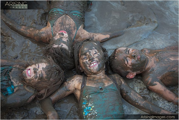 professional photos of kids playing in the mud