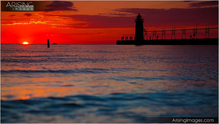 lighthouse in south haven, mi at sunset