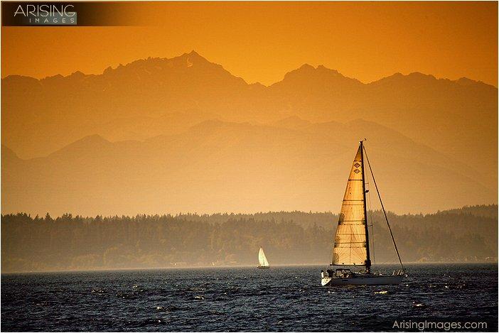 golden gardens beach park sunrise with olympic mountains