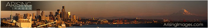 panoramic downtown seattle at sunset with mt. rainier