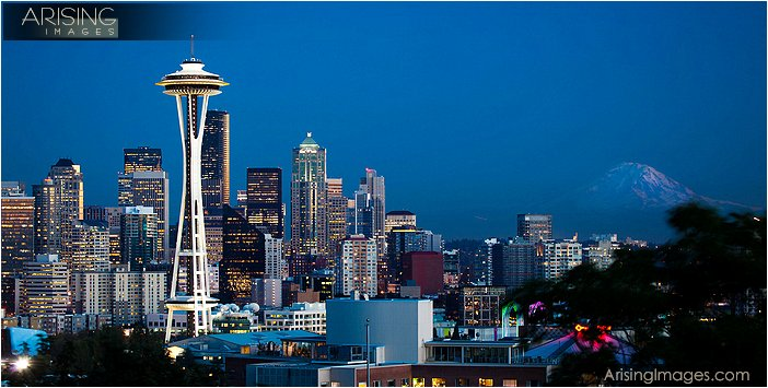 evening shot of downtown seattle with mt. rainier from the queen anne district