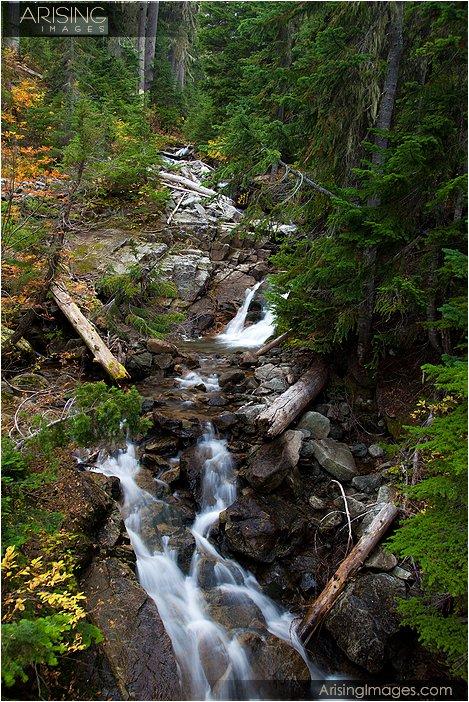 small waterfall on the hike to rainy lake in washington