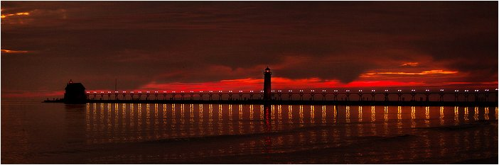 sunset with light house and pier