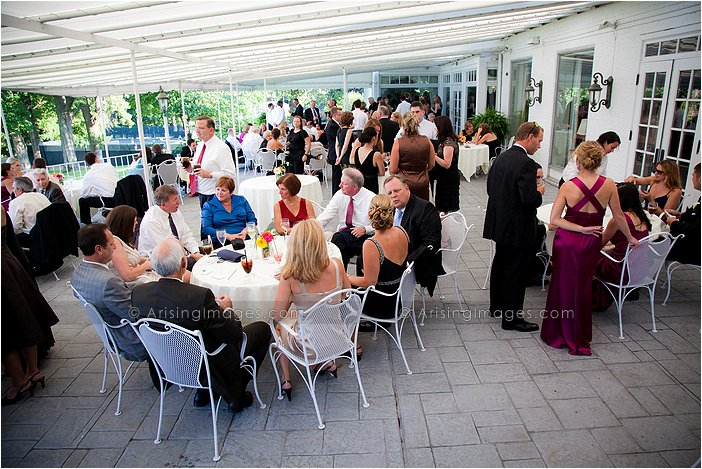 mingling guests at pleasant outdoor michigan wedding reception at orchard lake country club