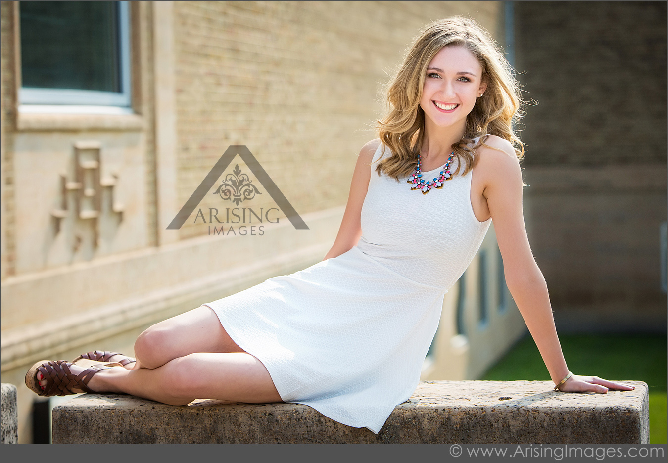 Senior pictures with brick wall