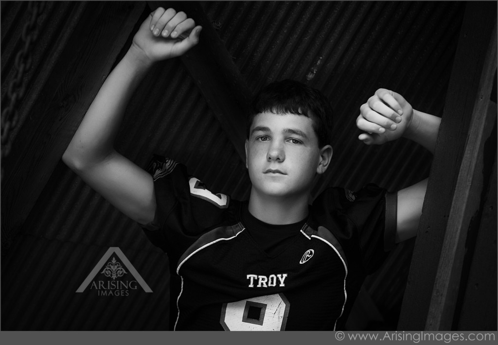 Senior pictures with football jersey
