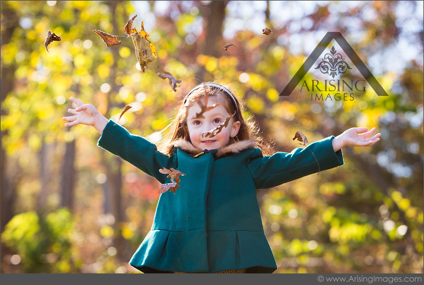 Pictures of kids throwing leaves