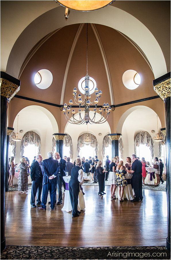 Tall ceilings and neutral colored walls enhance any wedding reception regardless of the color theme. Your indoor wedding reception photography will turn out fantastic because of the subtle yet intricate decor of the Grosse Pointe Yacht Club banquet hall.
